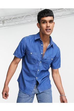 Tommy Hilfiger Short sleeve denim shirt in mid wash blue-Blues