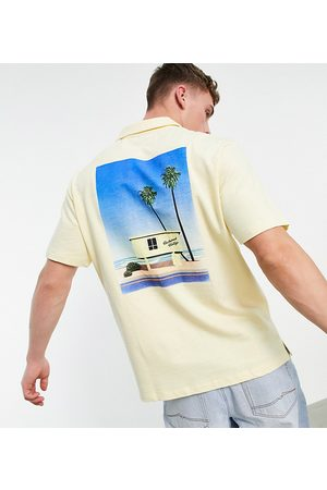 Reclaimed Inspired jersey shirt with holiday graphic