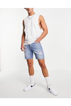 Topman Ripped slim denim shorts in mid wash-Blues