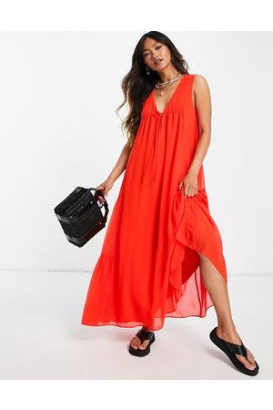 ASOS Sleeveless trapeze maxi dress with tie detail and side tiers