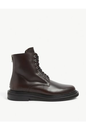 The Kooples Logo-embossed round-toe leather boots
