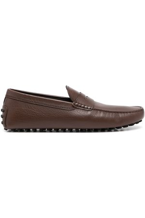Tod's Almond-toe pebbled-texture loafers