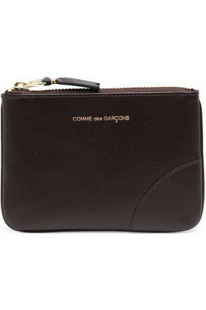 Comme des Garçons Debossed-logo leather pouch