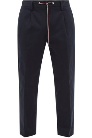 Moncler Men Pants - Pleated Cotton-blend Twill Trousers - Mens - Dark Navy
