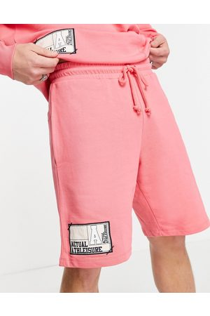 ASOS Coordinating oversized shorts with cut and sew paneling and logo woven patches in