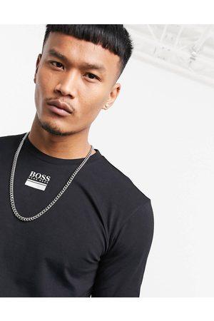 HUGO BOSS Togn 2 contrast logo long sleeve top in / white