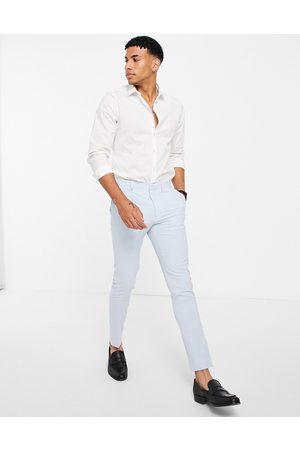 ASOS Super skinny suit pants in pastel blue-Blues