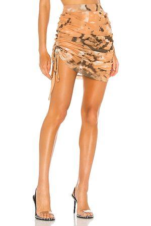 KIM SHUI Shirred Mesh Skirt in Burnt Orange.