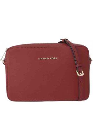 Michael Kors Jet Set leather clutch bag