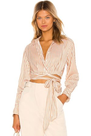 Free People X REVOLVE My Everything Wrap Top in Orange.