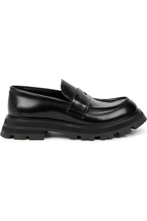 Alexander McQueen Glossed leather loafers