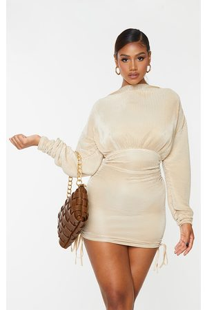 PRETTYLITTLETHING Champagne Plisse Detail Long Sleeve Ruched Skirt Bodycon Dress