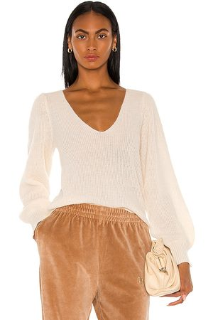 L'Academie Rosette Sweater in Ivory.