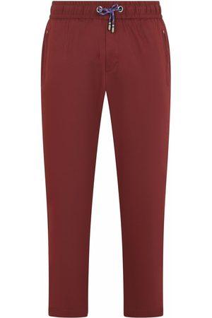 Dolce & Gabbana Fringed-logo track pants