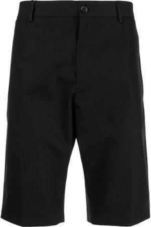 Dolce & Gabbana Men Shorts - Multi-patch tailored shorts