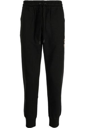 Dolce & Gabbana Men Sweatpants - Crest-embroidered track pants