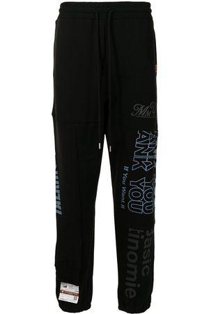 Maison Mihara Yasuhiro Men Sweatpants - Slogan-print track pants