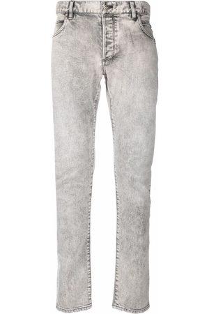 Balmain B-embossed skinny jeans - Grey