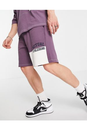 ASOS Set oversized short with color block cut and sew detailing and logo print in