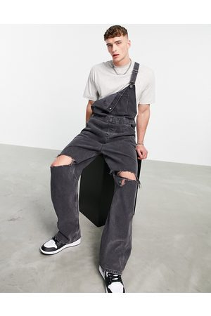 ASOS Baggy denim overalls in washed with knee rips