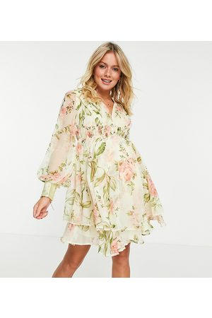 ASOS ASOS DESIGN Maternity pearl embellished button bodice mini dress with ruching detail and skirt slits in floral print