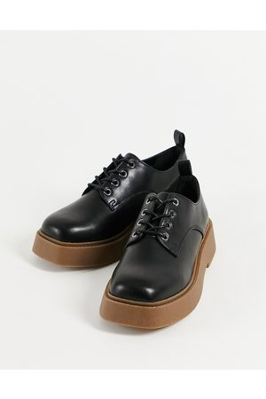 ASOS Martial chunky lace up flat shoes in