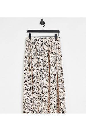ASOS ASOS DESIGN Petite button through midi skirt with deep pocket detail in animal print-Multi