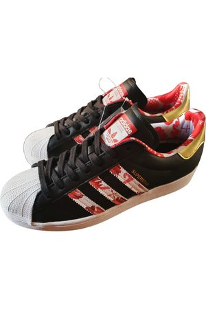 adidas Superstar leather low trainers