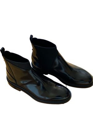 VALENTINO GARAVANI Patent leather boots