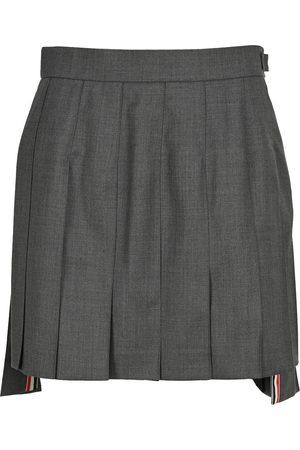 Thom Browne Women Mini Skirts - Mini dropped back pleated skirt