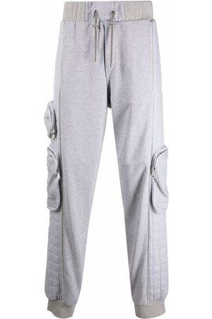 Balmain Men Sweatpants - Motif-print toggle-fastening track pants - Grey