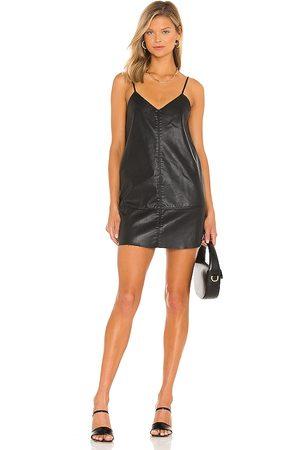 Free People Slip Into Something Mini Dress in Black.