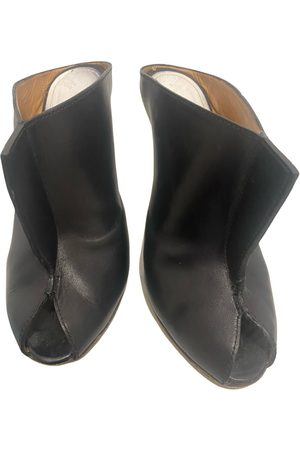 Maison Martin Margiela Women Mules - Leather mules & clogs