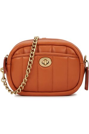 Coach Women Purses - Burnt orange quilted leather cross-body bag