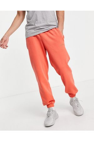 adidas Red over dyed trackpants in copper