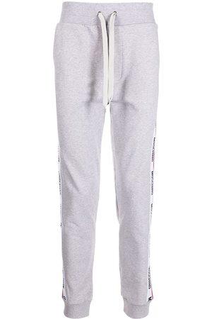 Moschino Logo-tape track pants - Grey