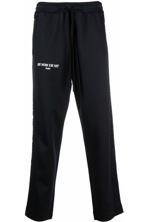 Ih Nom Uh Nit Men Sweatpants - Logo-print jersey sweatpants