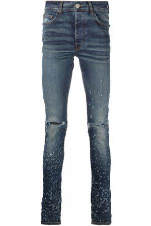 AMIRI Shotgun distressed skinny jeans