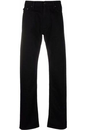 OFF-WHITE Diagonals print straight-leg jeans