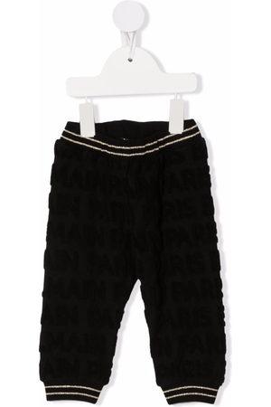 Balmain Chinos - All-over monogram trousers