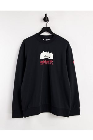 adidas Adventure logo sweatshirt in black