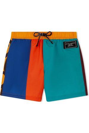 Dolce & Gabbana Boys Swim Shorts - Colourblock graffiti-logo swim shorts