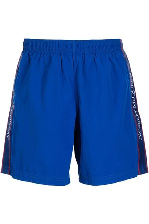 Alexander McQueen Men Flat Shoes - Logo-tape slip-on swim shorts