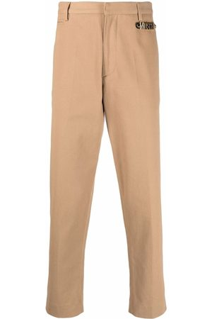 Moschino Logo-plaque tailored trousers - Neutrals