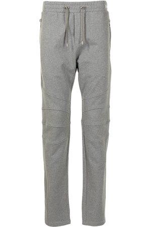 Balmain Men Sweatpants - Multicut printed track trousers - Grey