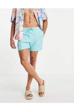 ASOS Swim shorts in blue mid length-Blues