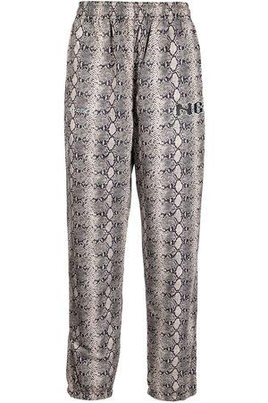 NOON GOONS Men Sweatpants - Snakeskin print track pants - Neutrals
