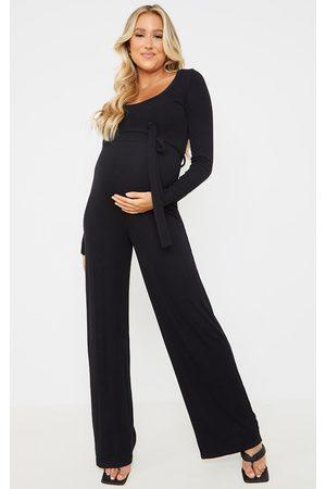 PRETTYLITTLETHING Women Jumpsuits - Maternity Soft Rib Tie Waist Jumpsuit