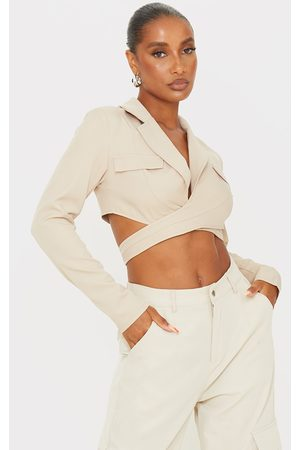 PrettyLittleThing Stone Woven Pocket Detail Wrap Waist Long Sleeve Crop Shirt