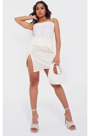 PRETTYLITTLETHING Petite Stone Tailored Satin Split Front Mini Skirt